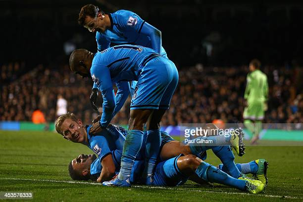 Lewis Holtby of Tottenham Hotspur celebrates with his teammates after scoring the second and winning goal for Tottenham Hotspur during the Barclays...