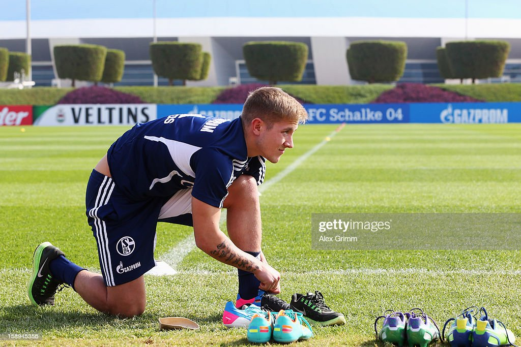 <a gi-track='captionPersonalityLinkClicked' href=/galleries/search?phrase=Lewis+Holtby&family=editorial&specificpeople=5351202 ng-click='$event.stopPropagation()'>Lewis Holtby</a> prepares for a Schalke 04 training session at the ASPIRE Academy for Sports Excellenc on January 4, 2013 in Doha, Qatar.