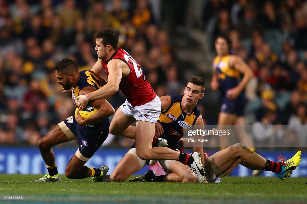 <a gi-track='captionPersonalityLinkClicked' href=/galleries/search?phrase=Lewis+Jetta&family=editorial&specificpeople=6544948 ng-click='$event.stopPropagation()'>Lewis Jetta</a> of the Eagles gets tackled by Jackson Merrett of the Bombers during the round 15 AFL match between the West Coast Eagles and the Essendon Bombers at Domain Stadium on June 30, 2016 in Perth, Australia.