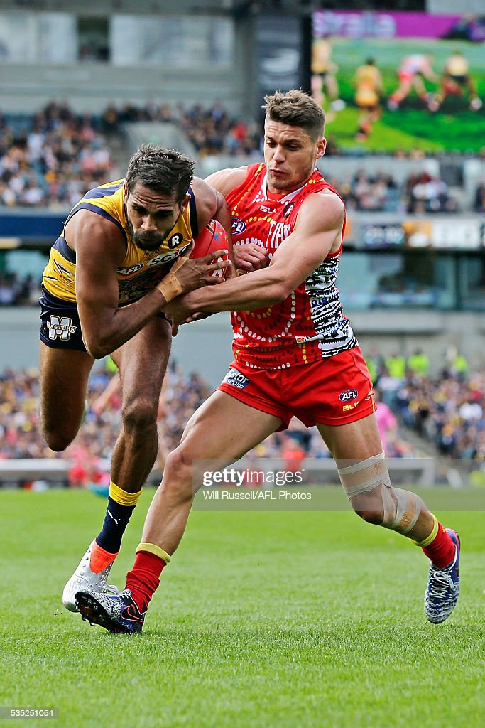 <a gi-track='captionPersonalityLinkClicked' href=/galleries/search?phrase=Lewis+Jetta&family=editorial&specificpeople=6544948 ng-click='$event.stopPropagation()'>Lewis Jetta</a> of the Eagles is tackled by Dion Prestia of the Suns during the round 10 AFL match between the West Coast Eagles and the Gold Coast Suns at Domain Stadium on May 29, 2016 in Perth, Australia.