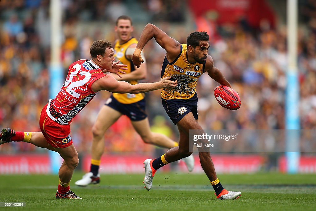 <a gi-track='captionPersonalityLinkClicked' href=/galleries/search?phrase=Lewis+Jetta&family=editorial&specificpeople=6544948 ng-click='$event.stopPropagation()'>Lewis Jetta</a> of the Eagles looks to break from a tackle by Brandon Matera of the Suns during the round 10 AFL match between the West Coast Eagles and the Gold Coast Suns at Domain Stadium on May 29, 2016 in Perth, Australia.