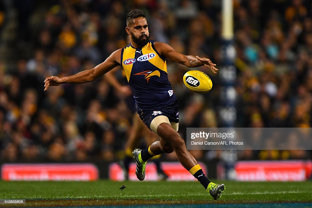 Lewis Jetta of the Eagles looks to kick from centre wing during the 2016 AFL Round 14 match between the West Coast Eagles and the Essendon Bombers at Domain Stadium on June 30, 2016 in Perth, Australia.