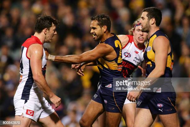 Lewis Jetta of the Eagles pushes Michael Hibberd of the Demons during the round 14 AFL match between the West Coast Eagles and the Melbourne Demons...