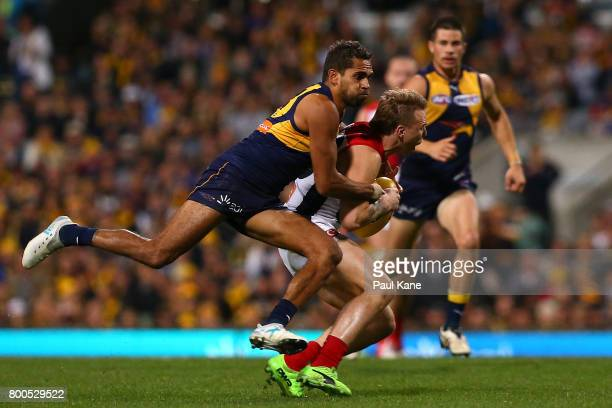 Lewis Jetta of the Eagles tackles James Harmes of the Demons during the round 14 AFL match between the West Coast Eagles and the Melbourne Demons at...