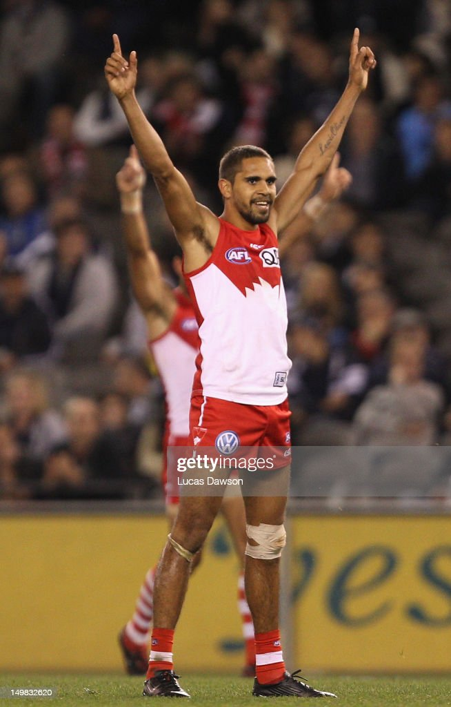 Lewis Jetta of the Swans celebrates a goal during the round 19 AFL match between the Carlton Blues and the Sydney Swans at Etihad Stadium on August 5, 2012 in Melbourne, Australia.