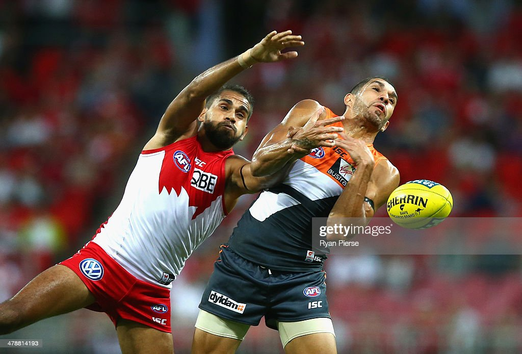 <a gi-track='captionPersonalityLinkClicked' href=/galleries/search?phrase=Lewis+Jetta&family=editorial&specificpeople=6544948 ng-click='$event.stopPropagation()'>Lewis Jetta</a> of the Swans competes for the ball against Curtly Hampton of the Giants during the round one AFL match between the Greater Western Sydney Giants and the Sydney Swans at Spotless Stadium on March 15, 2014 in Sydney, Australia.