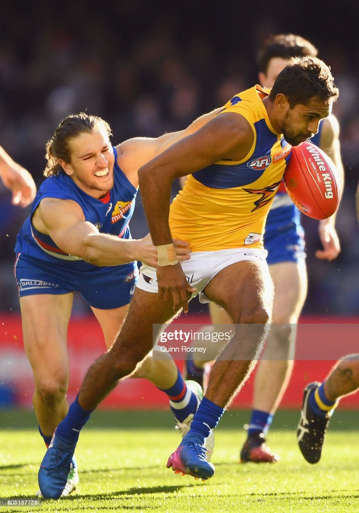 Lewis Jetta of the Swans is tackled by Marcus Bontempelli of the Bulldogs during the round 15 AFL match between the Western Bulldogs and the West Coast Eagles at Etihad Stadium on July 1, 2017 in Melbourne, Australia.