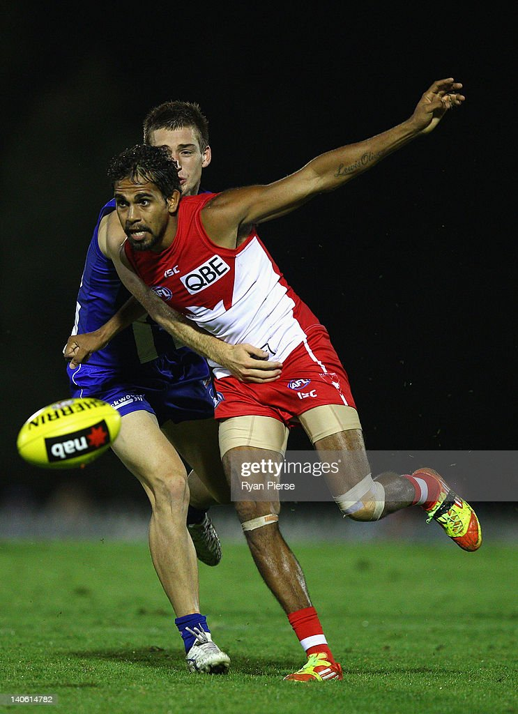 <a gi-track='captionPersonalityLinkClicked' href=/galleries/search?phrase=Lewis+Jetta&family=editorial&specificpeople=6544948 ng-click='$event.stopPropagation()'>Lewis Jetta</a> of the Swans is tackled by Shaun Atley of the Kangaroos during the round two NAB Cup AFL match between the Sydney Swans and the North Melbourne Kangaroos at Bruce Purser Oval on March 3, 2012 in Sydney, Australia.