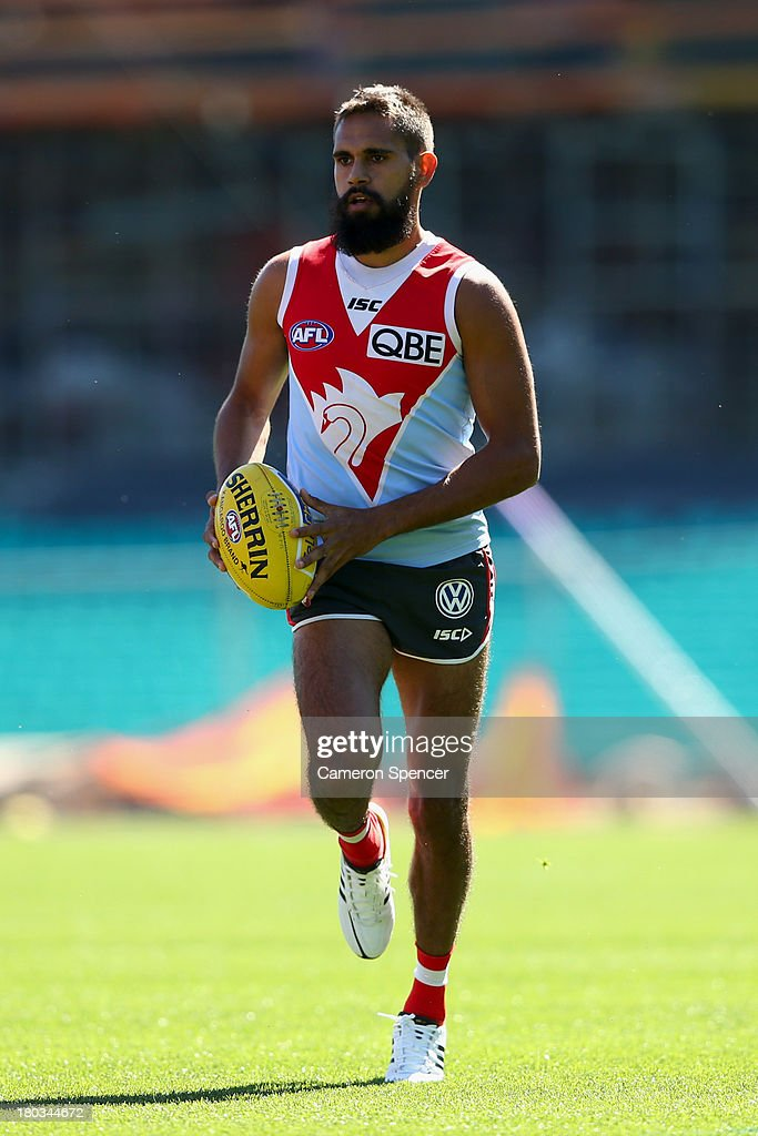 <a gi-track='captionPersonalityLinkClicked' href=/galleries/search?phrase=Lewis+Jetta&family=editorial&specificpeople=6544948 ng-click='$event.stopPropagation()'>Lewis Jetta</a> of the Swans runs during a Sydney Swans AFL training session at Sydney Cricket Ground on September 12, 2013 in Sydney, Australia.