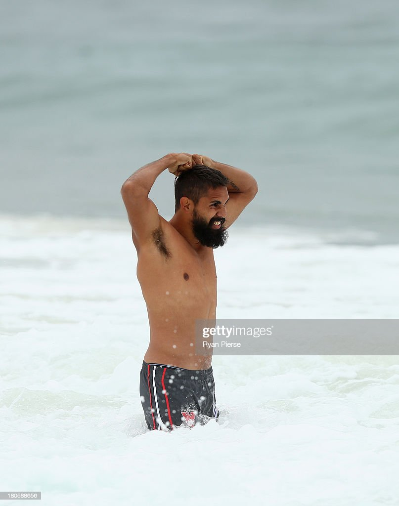 <a gi-track='captionPersonalityLinkClicked' href=/galleries/search?phrase=Lewis+Jetta&family=editorial&specificpeople=6544948 ng-click='$event.stopPropagation()'>Lewis Jetta</a> of the Swans swims during a recovery session at Coogee Beach on September 15, 2013 in Sydney, Australia.