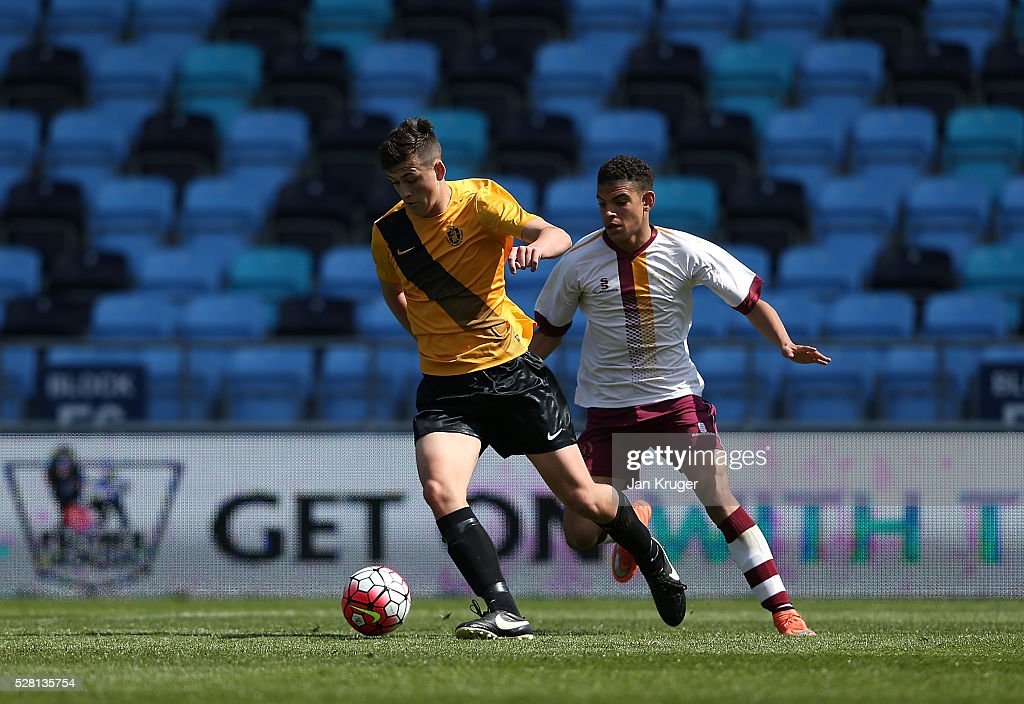 Lewis Jones of Samuel Whitbread Academy(L) battles with Morgan Gibbs-White of Thomas Telford School during the under 16 Schools' Cup final match between Thomas Telford School and Samuel Whitbread Academy at the Academy Training Ground on May 04, 2016 in Manchester, England.