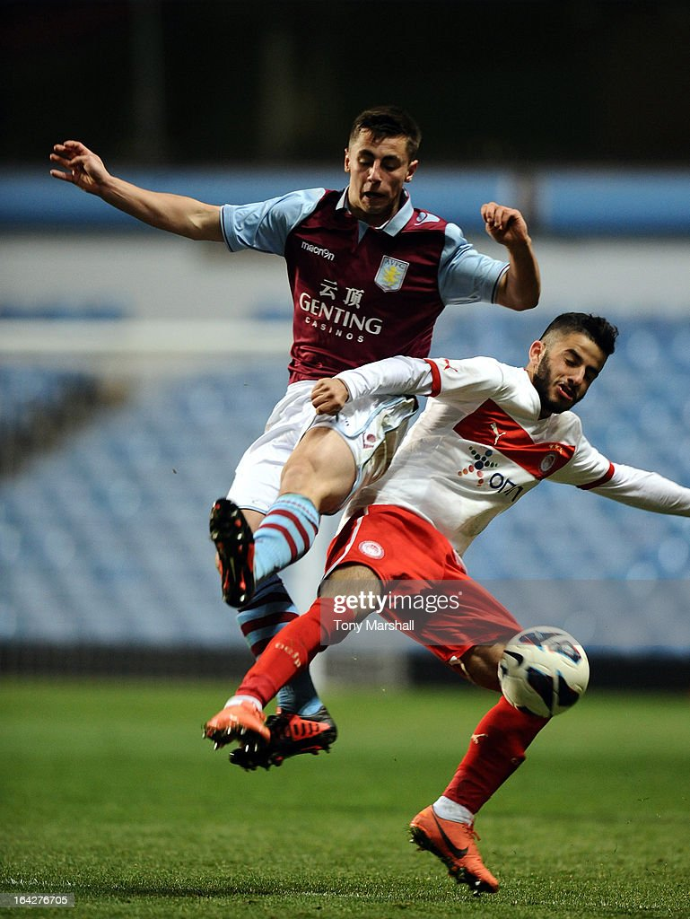 Lewis Kinsella (L) of Aston Villa clashes with Dimitrios Siopis of Olympiacos during the NextGen Series Quarter Final match between Aston Villa U19 and Olympiacos U19 at Villa Park on March 20, 2013 in Birmingham, England.