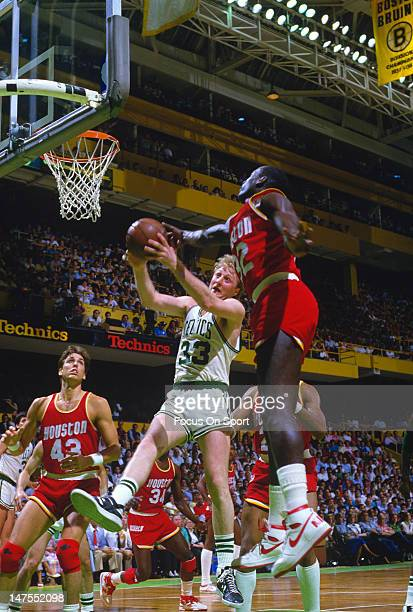 Lewis Lloyd of the Houston Rockets attempts to block the shot of Larry Bird of the Boston Celtics during an NBA basketball game circa 1984 at The...