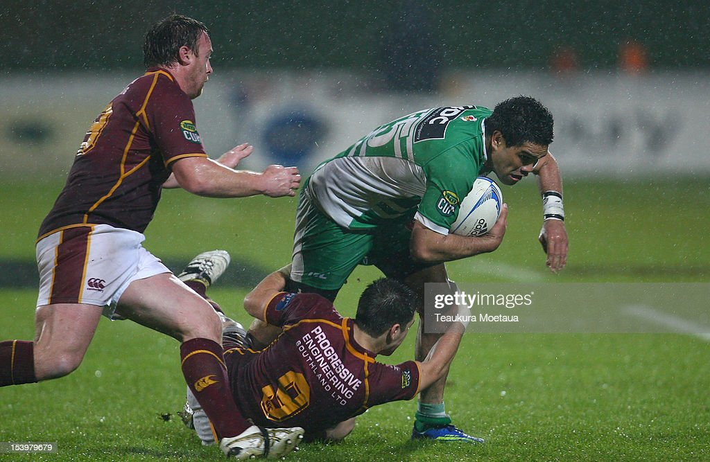 Lewis Marshall of Manawatu is tackled during the round 15 ITM Cup match between Southland and Manawatu at Rugby Park Stadium on October 12 2012 in...