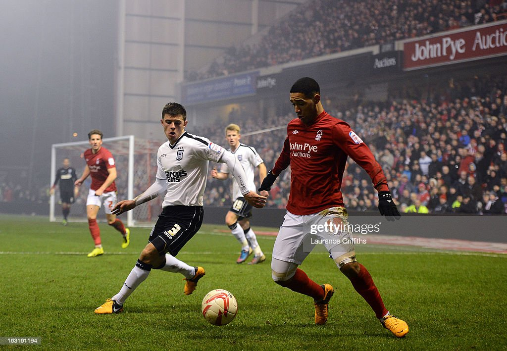 Lewis McGugan of Nottingham Forest is closed down by Aaron Cresswell of Ipswich during the npower Championship match between Nottingham Forest and Ipswich Town at City Ground on March 5, 2013 in Nottingham, England.