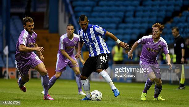 Lewis McGugan of Sheffield is challenged by Orlando Sa and Stephen Quinn of Reading during the Sky Bet Championship match between Sheffield Wednesday...