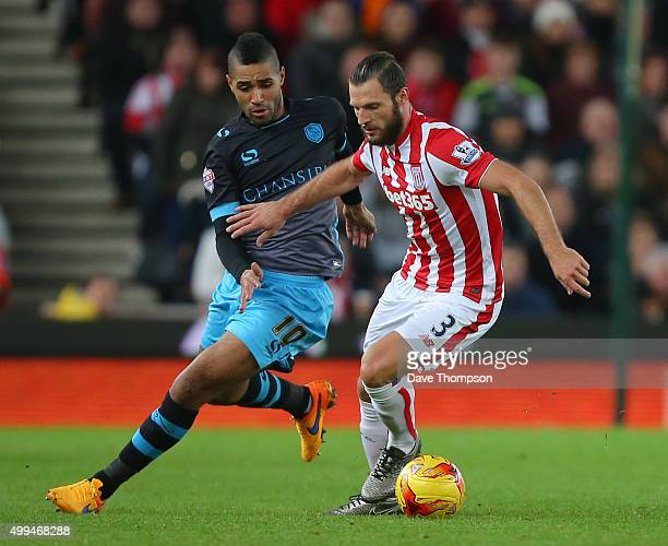 Lewis McGugan of Sheffield Wednesday and Erik Pieters of Stoke City during the Capital One Cup match between Stoke City and Sheffield Wednesday at...