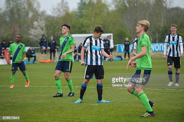 Lewis McNall of Newcastle celebrates after taking a penalty and scoring their fourth goal during the U18 Premier League Match between Newcastle...
