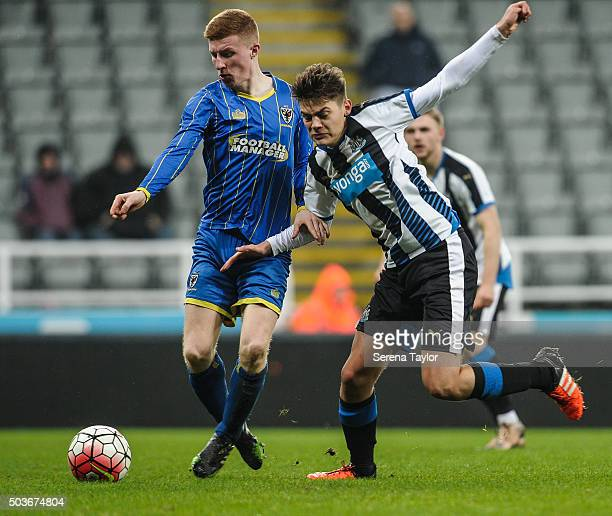 Lewis McNall of Newcastle challenges Seanan McKillop of Wimbledon during the U18 FA Youth Cup Match between Newcastle United and AFC Wimbledon at...