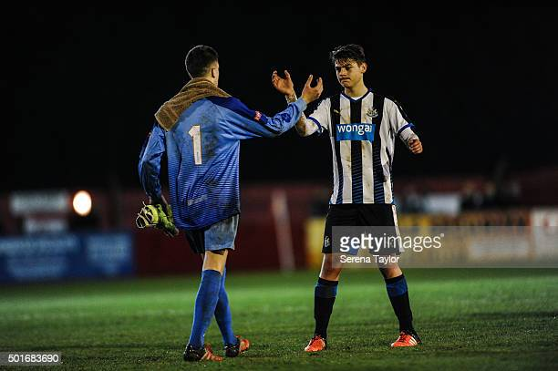 Lewis McNall of Newcastle is congratulated by Ilkeston Town goalkeeper Jamie Hannis on the pitch after Newcastle win the U18 FA Youth Cup Match...