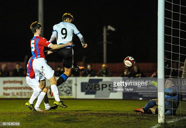 Lewis McNall of Newcastle scores the opening goal during the U18 FA Youth Cup Match between Ilkeston and Newcastle United at The New Manor Ground on...