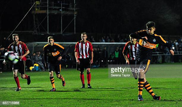 Lewis McNall of Newcastle United scores the opening goal from the penalty spot during the Fifth round of the FA Youth Cup match between Sunderland...