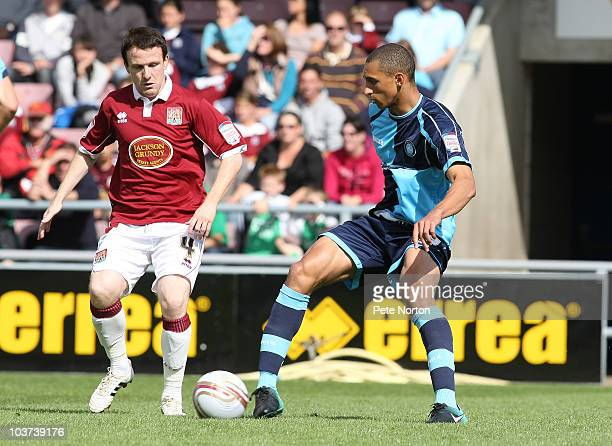 Lewis Montrose of Wycombe Wanderers looks to play the ball watched by Kevin Thornton of Northampton Town during the npower LeagueTwo match between...