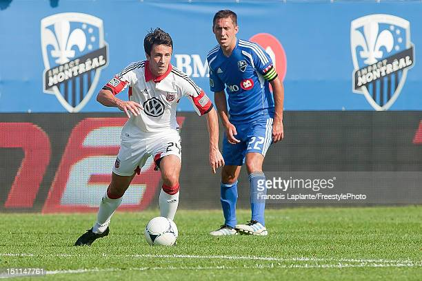 Lewis Neal of the DC United controls the ball past Davy Arnaud of the Montreal Impact during the MLS match at Saputo Stadium on August 25 2012 in...