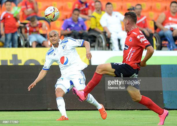 Lewis Ochoa of Millonarios struggles for the ball with Jhon Hernandez of Medellin during a match between Independiente Medellin and Millonarios as...