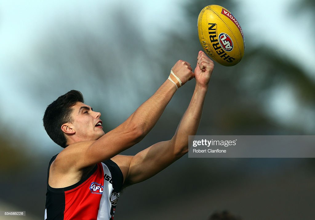 Lewis Pierce of the Saints punches the ball during a St Kilda Saints AFL training session at Moorabbin Oval on May 27, 2016 in Melbourne, Australia.