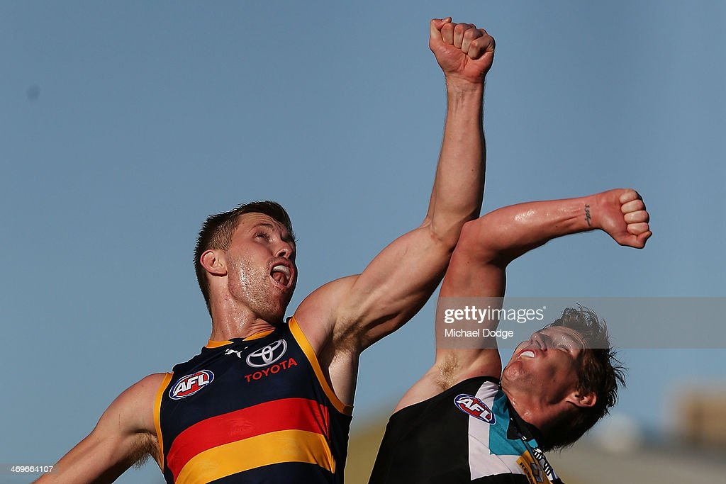Lewis Stevenson of the Power and Shaun McKernan of the Crows contest for the ball during the round two AFL NAB Challenge Cup match between the...