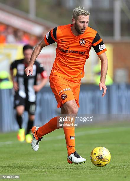Lewis Toshney of Dundee United controls the ball during the Betfred League Cup group match between Dundee United and Dunfermline Athletic at...