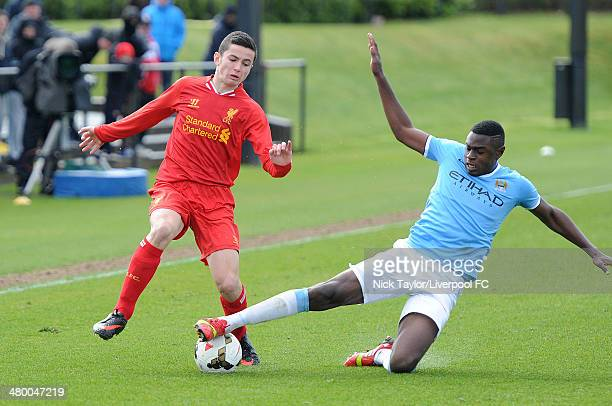Lewis Travis of Liverpool and Nathaniaz Oseni of Manchester City in action during the Barclays Premier League Under 18 fixture between Liverpool and...