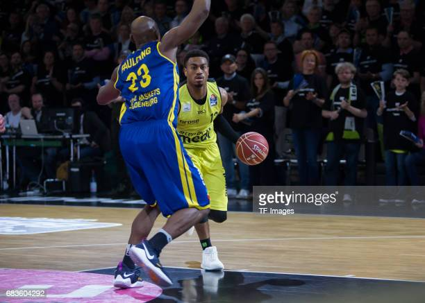 Lewis Trey of medi bayreuth and Paulding Rickey of Oldenburg battle for the ball during the easyCredit BBL match between medi bayreuth and EWE...