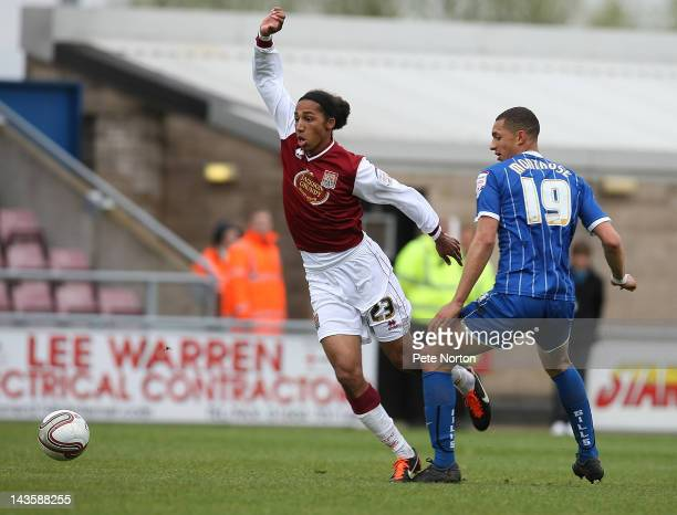 Lewis Wilson of Northampton Town moves away with the ball from Lewis Montrose of Gillingham during the League Two match between Northampton Town and...