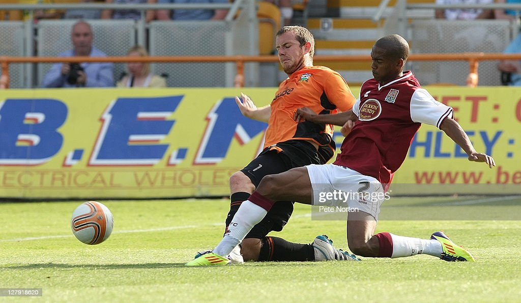 Lewis Young of Northampton Town challenges for the ball with Gary Borrowdale of Barnet during the npower League Two match between Barnet and Northampton Town at Underhill Stadium on October 1, 2011 in Barnet, England.