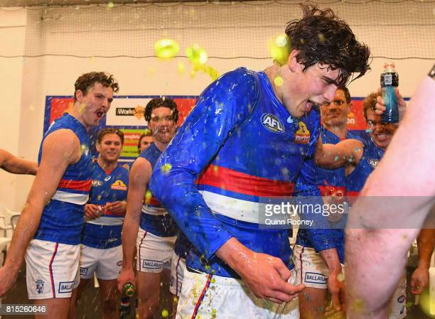 Lewis Young of the Bulldogs is sprayed with drinks after winning the round 17 AFL match between the Carlton Blues and the Western Bulldogs at...