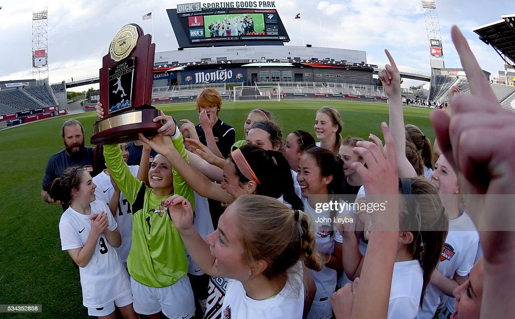 Lewis-Palmer Rangers gk Haley Arsenault (1) holds up the 4A state soccer championship trophy with her teammates after defeating Valor Christian Eagles 1-0 May 25, 2016 at Dicks Sporting Goods Park.