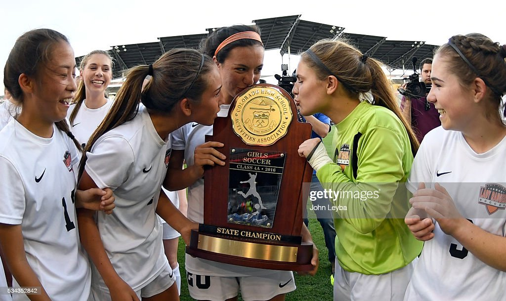 Lewis-Palmer Rangers Jenny Allenspach (4) Lewis-Palmer Rangers Karly Sandoval (20) and Lewis-Palmer Rangers gk Haley Arsenault (1) kiss the 4A state soccer championship trophy after defeating Valor Christian Eagles 1-0 May 25, 2016 at Dicks Sporting Goods Park.