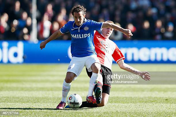Lex Immers of Feyenoord and Andres Guardado of PSV battle for the ball during the Dutch Eredivisie match between Feyenoord and PSV Eindhoven at De...