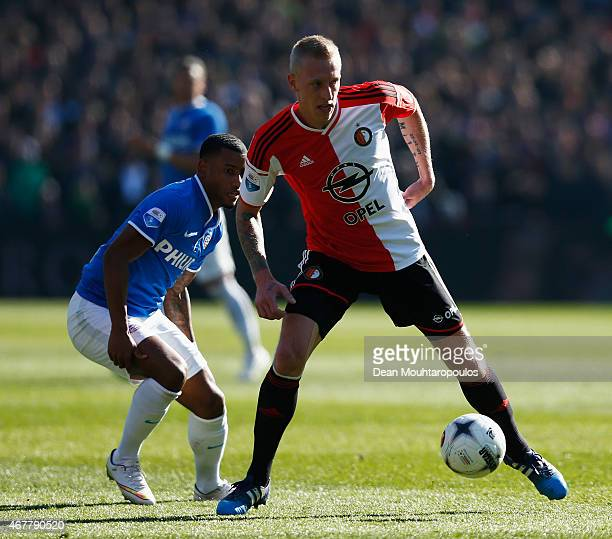 Lex Immers of Feyenoord and Luciano Narsingh of PSV battle for the ball during the Dutch Eredivisie match between Feyenoord and PSV Eindhoven at De...