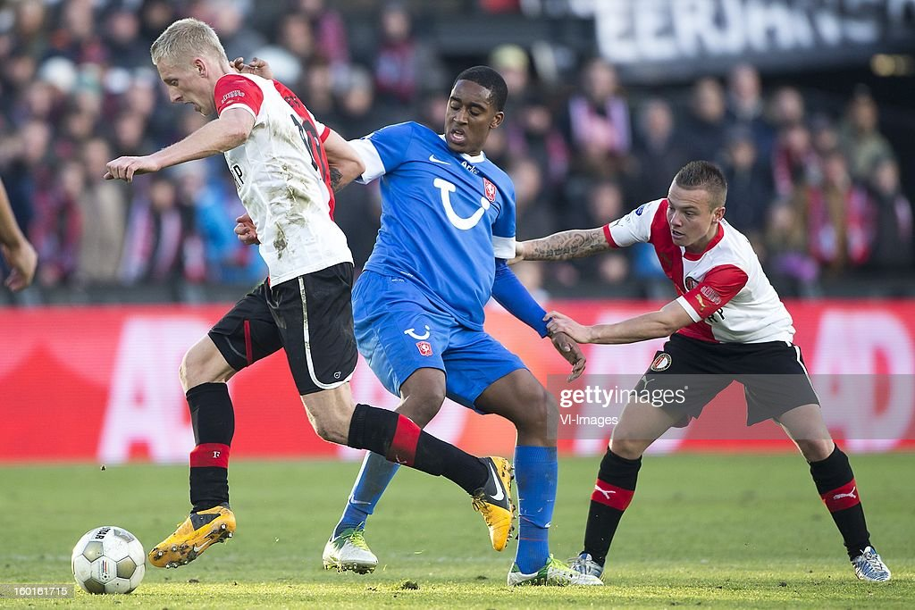 Lex Immers of Feyenoord, Leroy Fer of FC Twente, Jordy Clasie of Feyenoord during the Dutch Eredivise match between Feyenoord and FC Twente at stadium De Kuip on January 27, 2013 in Rotterdam, The Netherlands.