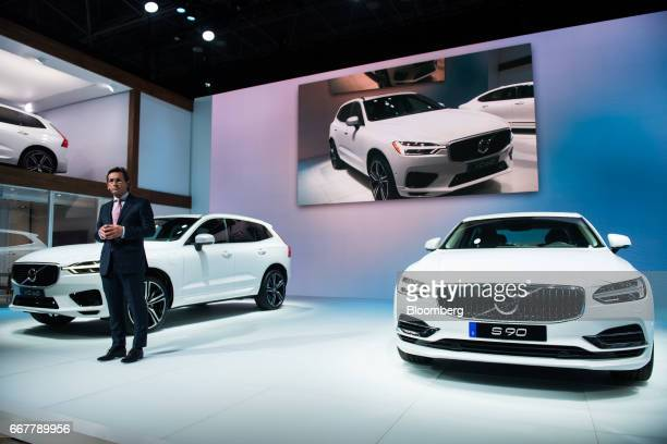 Lex Kerssemakers senior vice president of Volvo Cars of North America LLC stands between the Volvo AB XC60 left and S 90 vehicles during the 2017 New...