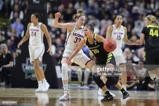 Lexi Bando of the Oregon Ducks defended by Katie Lou Samuelson of the Connecticut Huskies during the UConn Huskies Vs Oregon Ducks NCAA Women's...