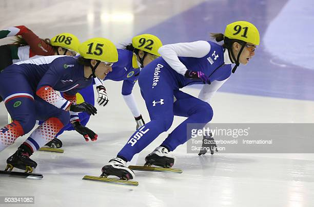 Lexi Burkholder of the United States competes against Veronique Pierron of France on Day 1 of the ISU World Cup Short Track Speed Skating competition...