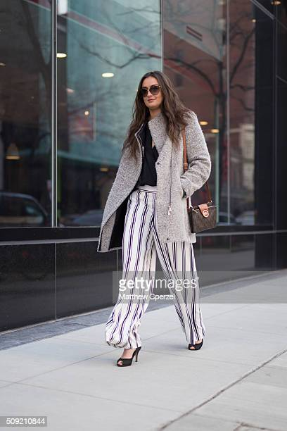 Lexi Mantas is seen on Michigan Avenue wearing Tom Ford glasses grey wool Calvin Klein coat black Topshop shirt white/navy striped 1State pants brown...
