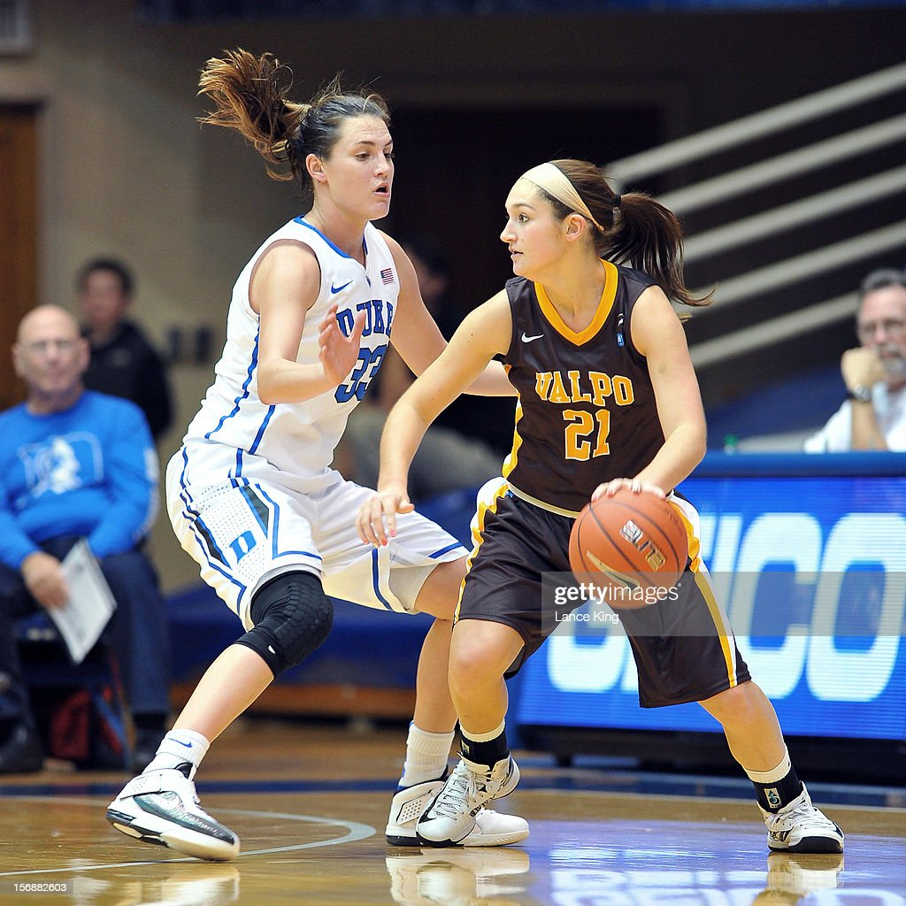 Lexi Miller #21 of the Valparaiso Crusaders dribbles against Haley Peters #33 of the Duke Blue Devils at Cameron Indoor Stadium on November 23, 2012 in Durham, North Carolina.