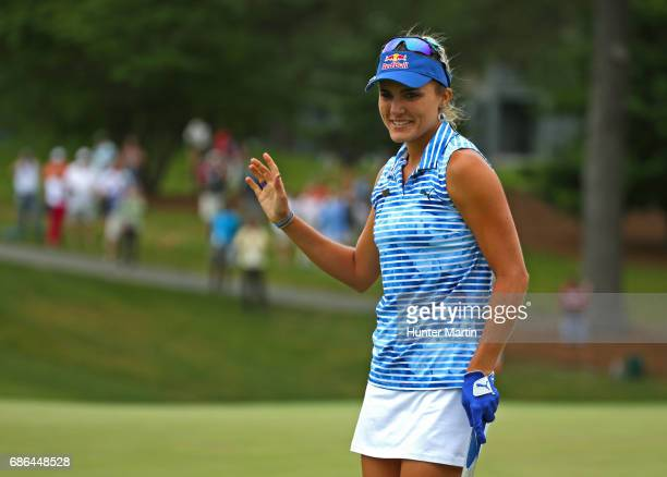 Lexi Thompson acknowledges the crowd after making her birdie putt on the ninth hole during the final round of the Kingsmill Championship presented by...