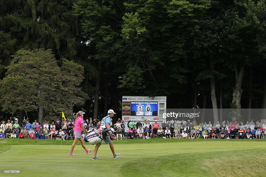 Lexi Thompson and her caddie walk to her ball on the third hole during the third round of the Wegmans LPGA Championship at Monroe Golf Club on August 16, 2014 in Pittsford, New York.