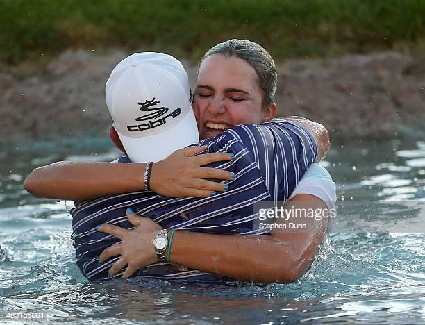 Lexi Thompson celebrates with father Scotti Thompson after taking the leap into Poppie's Pond after her victory during the final round of the Kraft...